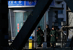 Chinese soldiers stand guard at an immigration inspection post on the Sino-Korean Friendship Bridge connecting Sinuiju, North Korea, along the Yalu River in the Chinese city of Dandong, Liaoning Province, China on 06 April 2013. North Korean leader Kim Jong-un has ordered the country's military to increase artillery production, a televised report out of Pyongyang showed 06 April.