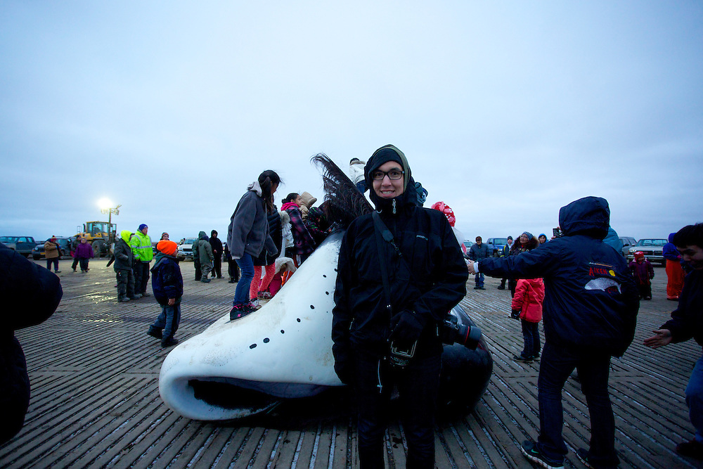BARROW, AK - 2013: Brian Adams in front of a bowhead whale that had just been hunted in Barrow, Alaska.