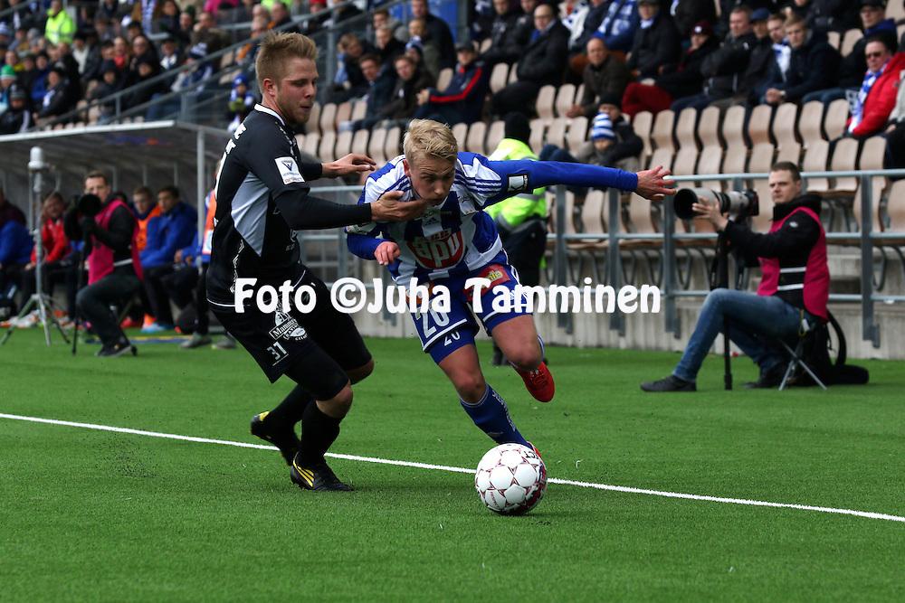 19.4.2015, Sonera stadion, Helsinki.<br /> Veikkausliiga 2015.<br /> Helsingin Jalkapalloklubi - FC Lahti..<br /> Matti Klinga (HJK) v Jussi L&auml;nsitalo (FC Lahti).