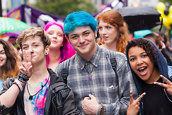 London, June 28th 2014. Young people pose for the camera as the Pride London parade proceeds through the city's streets.