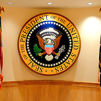 Presidential Seal at John F. Kennedy Presidential Library and Museum in Boston, Massachusetts<br /> The logo for the President of the United States was defined by executive order in 1960 but versions were used over 100 years before then.  Only one official seal die exists and it&rsquo;s still used to close official envelopes from the President to Congress.  This display is at the John F. Kennedy Presidential Library and Museum in Boston, Massachusetts.