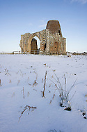 St Benet's Abbey, Ludham, Norfolk Broads N.P. View across snow covered field.