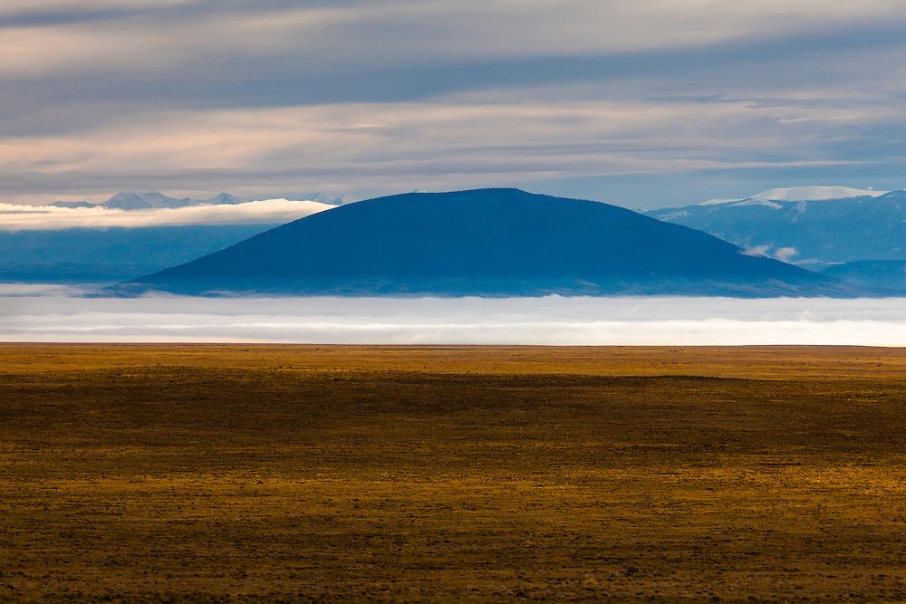 Fog surrounds Ute Mountain. Rio Grande del Norte National Monument in northern New Mexico.