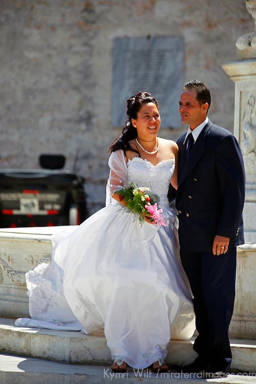 Central America, Cuba, Havana. A Cuban bride and groom in Old Havana.