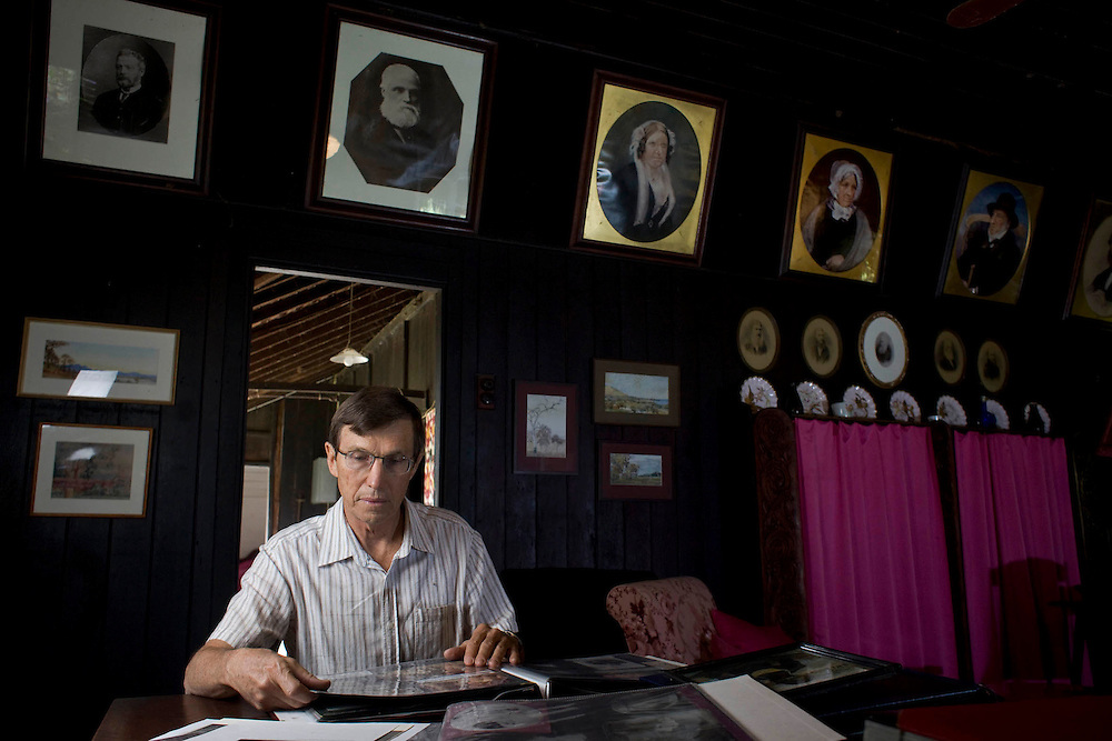 "Repatriation of aboriginal remains from Europe and the U.S. to back to Australia story..Bruce Foster son of Alison Archer on the ""Archer Farm family property in the dinning room lounge room with the portraits of the family on the wall."