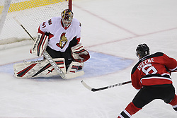 Apr 7; Newark, NJ, USA; Ottawa Senators goalie Craig Anderson (41) makes a save on New Jersey Devils defenseman Andy Greene (6) during the second period at the Prudential Center.