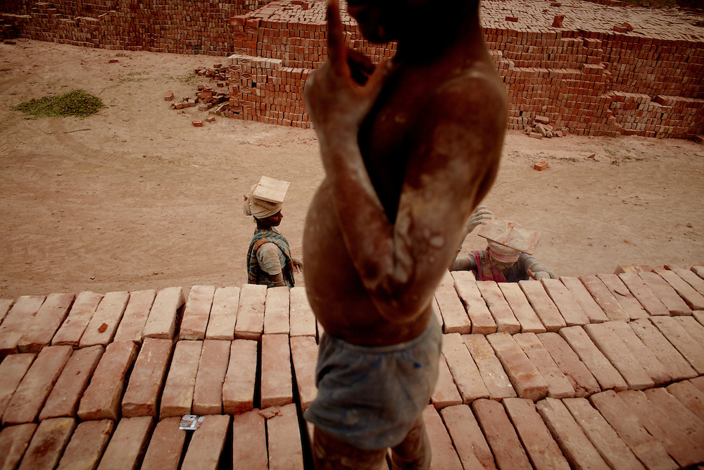 "By the village of Naseer Kheda, a brickfactory employs the inhabitants. The pay of IRS2600/month is paid at the discretion of the employer as is the treatment of workhours.  ""You work until you are either too tired to continue, or the boss is happy with the results"".Ram Kumar. .?The caste system in India was abolished by law 60 years ago, but is still deeply rooted in society where it is difficult but not impossible to move to a socially better place.?.Photo by: Eivind H. Natvig/MOMENT"