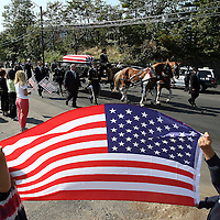 (09/28/06-Swampscott,MA) The funeral of Army Soldier Jared Raymond, age 20. Here, children hold an American Flag near the Swampscott cemetery.(092806raymondmg-Staff Photo:Mark Garfinkel.saved phto6/fri),
