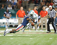 Ole Miss defensive back Quintavius Burdette (2) hits Tulane's Peter Picerelli (31) following a bad snap on a punt in the first half at the Mercedes-Benz Superdone in New Orleans, La. on Saturday, September 22, 2012. Ole Miss won 39-0...