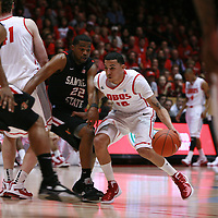 18 January 2012:  New Mexico Lobo #10 Kendall Williams dribbles the ball around Chase Tapley #22. San Diego State Aztecs defeated the New Mexico Lobos Lobos 75 - 70 at The Pit in Albuquerque, NM.