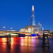 Blue hour at London Bridge with the Shard in the background. Height: 310 metres (1,017 feet)310 metres (1,017 feet).<br /> <br /> Architect: Renzo Piano