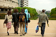 young adults walking with wine bottles, paris, ladefense