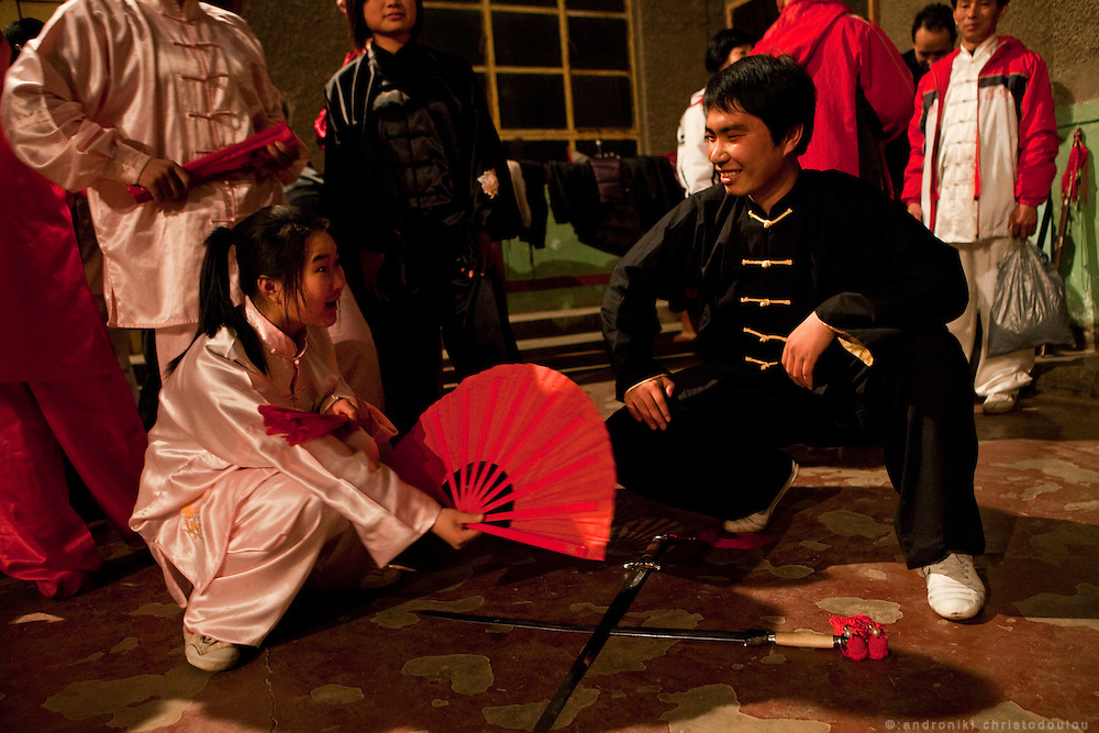Taijiquan student (left) talking with teacher Chen Hui (right) before a demonstration at Chenjiagou Taijiquan School.