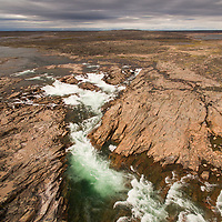 Canada, Nunavut Territory, Aerial view of waterfall near Bury Cove along west coast of Hudson Bay 100 miles south of the Arctic Circle