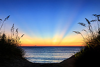 Dawn light rays on a Outer Banks beach in Duck NC.