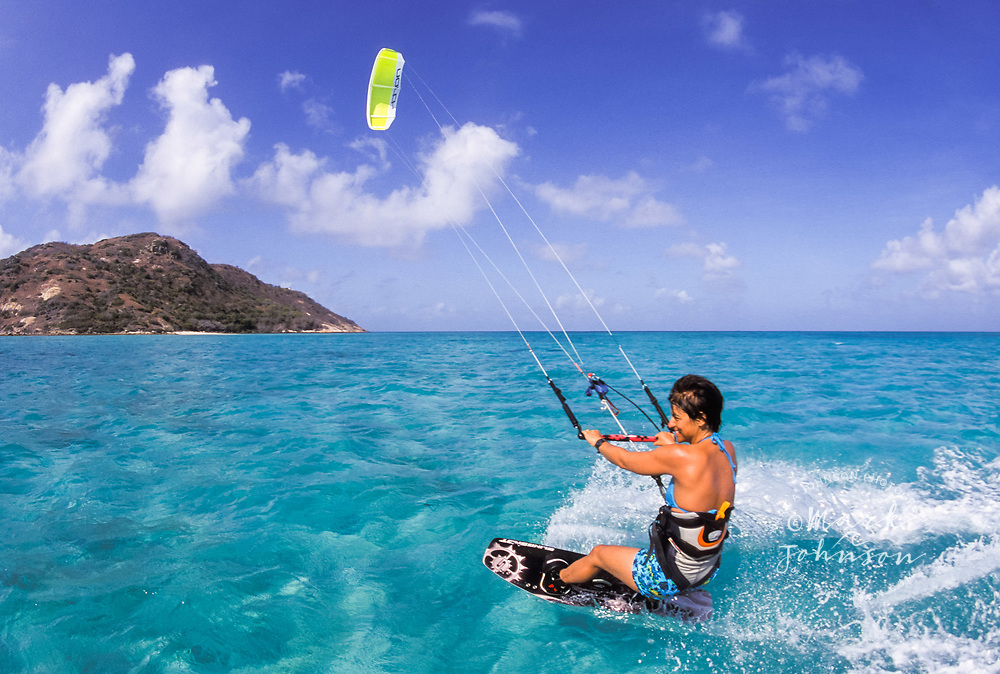 Australia, Qld., Great Barrier Reef, woman kitesurfing.  MR available.
