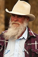Bearded cowboy in crowd, Miles City Bucking Horse Sale Parade, Montana