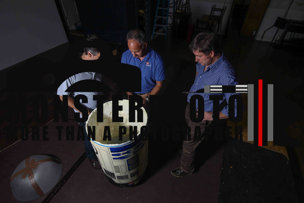 Bill Swezey (LEFT), Anthony DellAversano (CENTER) and Mark Dixon (RIGHT) makes adjustments to the model of R2D2 built by high school students during Bootless theatre production rehearsal of Star Wars the Musical Thursday, Oct 01, 2015, at St. Stephen's Church in Wilmington, Del.