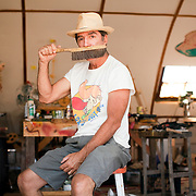 Poe Dismuke is a big ol' kid and he's having more fun than all of us. He sketches, sculpts, designs Rube Goldberg machines and builds soap-box-derby cars. He is a collector of the coolest crap you've ever seen, including a fuselage. As if that wasn't enough, he's married to the amazing Sam Woolcott. Together they own Sam Poe Gallery, located on Main Street in Bisbee.