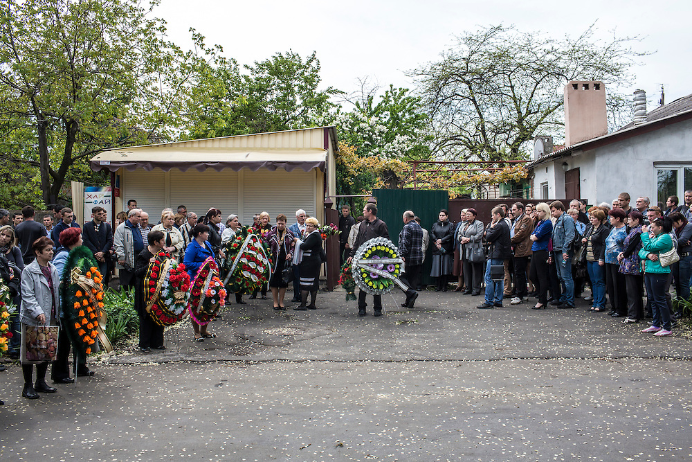 MARIUPOL, UKRAINE - MAY 12: Mourners attend the funeral of Alexey Vorobyov on May 12, 2014 in Mariupol, Ukraine. Vorobyov was a bystander when he was killed by a bullet during clashes at a local police station on May 9, with tensions heightened by the Victory Day holiday and a referendum on greater autonomy for the region arranged by pro-Russia activists. (Photo by Brendan Hoffman/Getty Images) *** Local Caption ***