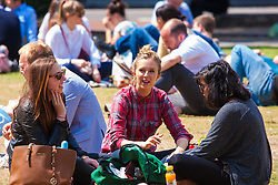 Finnsbury Square, London, June 18th 2015. City workers enjoy the lunch hour in the sunshine in Finsbury Square.