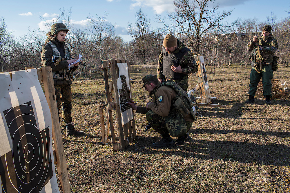Members of the Azov Brigade check their marksmanship during weapons training at one of the group's training grounds on Saturday, March 7, 2015 in Kulykivske, Ukraine. Photo by Brendan Hoffman, Freelance