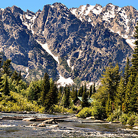 Snake River Flowing Below Teton Mountain Range in Grand Teton National Park, Wyoming<br /> The Cathedral Group is eight mountains with peaks from 11,300 to 13,770 feet in the Teton Range, Wyoming. On their eastern slope, the cold, picturesque waters of the Snake River winds through the spruce-fir forests and tundra of Jackson Hole valley and the Grand Teton National Park. The alpine serenity is stunning.