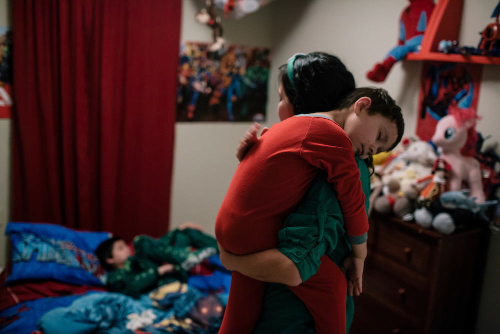 Larissa Camilleri wakes up her children, Nick, 5, and Eric, 8, early in the morning before school on March 17, 2015. Camilleri's husband, Matthew, is in the Army, and when they moved to DC from Germany, Camilleri was pregnant with their third child, Scarlett. Instead of looking for housing in the competitive DC market, they moved into housing on the base in a few days.