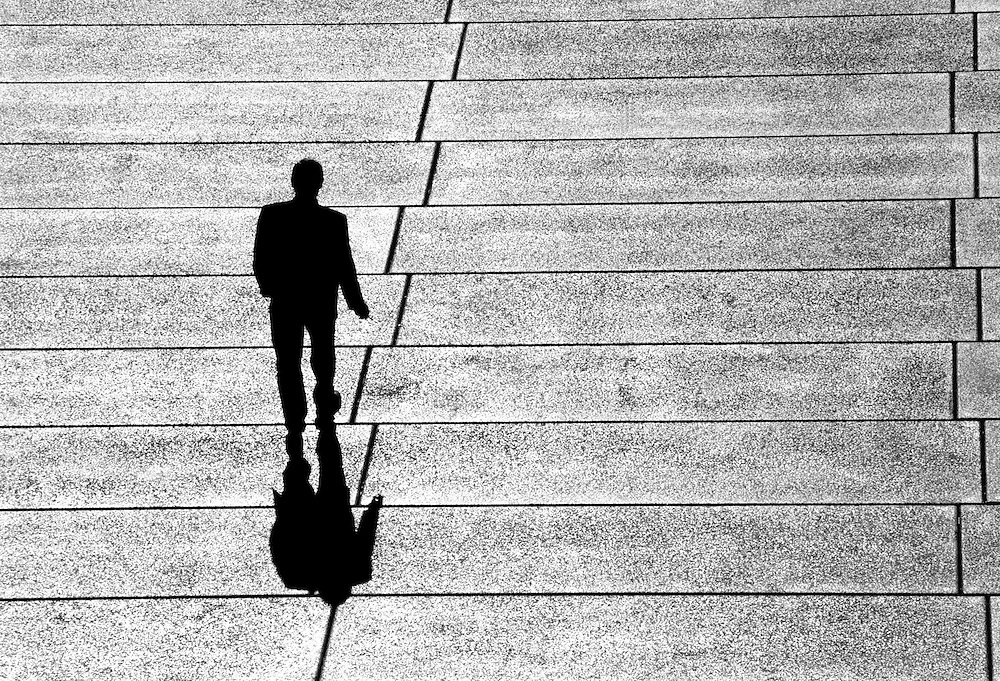 Businessman walking the Opera house forecourt. @ Martine Perret. 2006