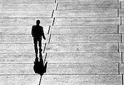 Businessman walking the Opera house forecourt. @ Martine Perret. 2006