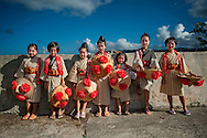 Young dancers at the Densaa Matsuri in remote village of Uehara on Iriomote Island.  Okinawa Prefecture, Japan.