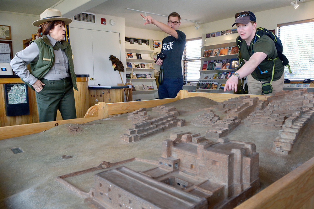 gbs041217e/STATE -- National Park Ranger Donna Deiner, left, answers questions of Mikah Meyer of Lincoln, Nebraska, center, and Tim Logan of Vancouver, Canada as they look at model of  the Quarai mission and Pueblo at Quarai visitors center on Wednesday, April 12, 2017. (Greg Sorber/Albuquerque Journal)