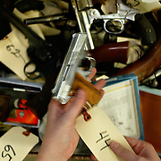 The 10th Annual Gun Turn-In sponsored by Ceasefire Oregon at six area sites collected hundreds on Saturday. Gresham Police CSI Melissa Arne stores handguns dropped off at Gresham Fire Station #4...