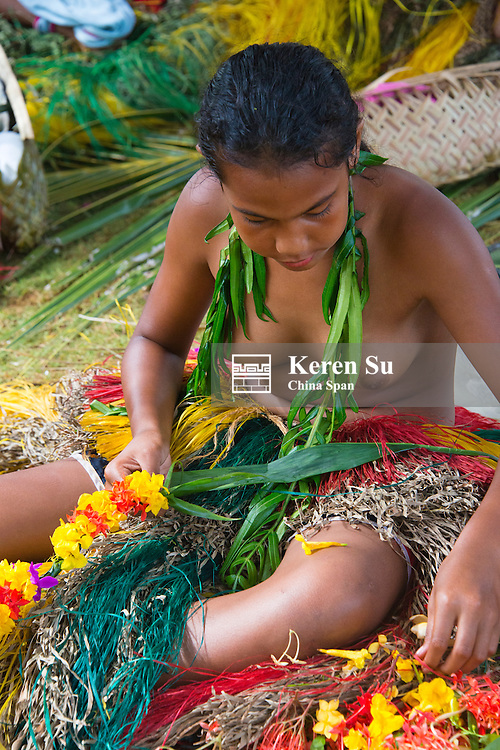 Yapese girls making flower lei for Yap Day Festival, Yap Island, Federated States of Micronesia