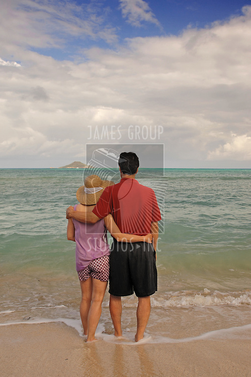 Mid-life aged romantic couple together on a tropical beach