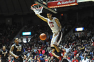 "Mississippi's Anthony Perez (13) dunks vs. Missouri at the C.M. ""Tad"" Smith Coliseum in Oxford, Miss. on Saturday, February 8, 2014. (AP Photo/Oxford Eagle, Bruce Newman)"