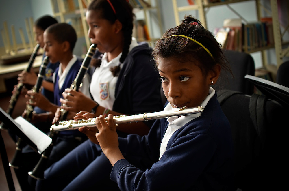 "Students in a beginners class practice playing their instruments in an after school program at the José Martí primary school in Sarría, a slum in Caracas, Venezuela. The school is a ""nucleo"" for El Sistema, Venezuela's nationwide classical music educational program."