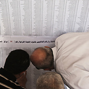 Egyptian men search for their names and voter station information on a list at a polling center during the historic first, truly democratic Presidential election May 23, 2012 in Cairo Egypt. Coming 15 months after the revolution that toppled the regime of former President Hosni Mubarak, the election will not only decide the leader of the country, but also set the tone and decide the course by which the country moves forward in democracy and reform.  (Photo by Scott Nelson)