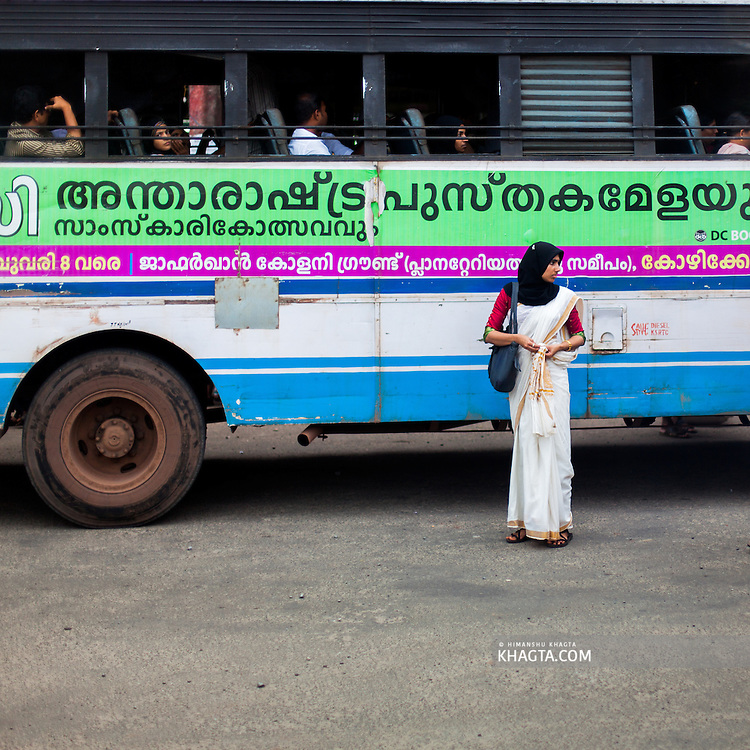 A lady walking in the streets of Kerala.