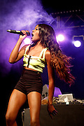 READING, ENGLAND - AUGUST 25:  Azealia Banks performs live on the Dance Stage on Day Two during the Reading Festival 2012 at Richfield Avenue on August 25, 2012 in Reading, England.  (Photo by Simone Joyner/WireImage)