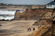 Coastal Erosion, Happisburgh on the North Norfolk coast, Britain. Managed retreat is being allowed to happen at many locations on the coast of Britain. Here at Happisburgh the north sea has destroyed all sea defences, the land has been eroded away by wind and sea and homes, property and WW2 gun emplacements have fallen onto the beach from the crumbling cliff edge..COPYRIGHT PHOTOGRAPH BY BRIAN HARRIS  © 2008.07808-579804