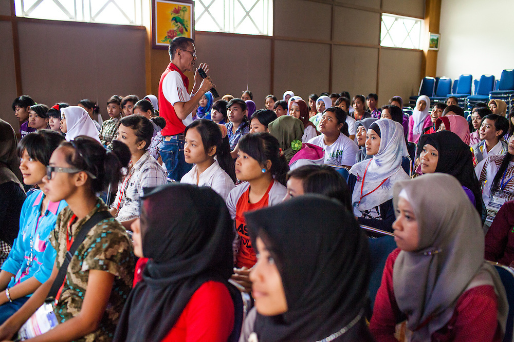 Recent graduates from the Development Center for Human Resources and Product Industry Enterprises or (Balai Pengembangan SDM & Produk IKM), undertake an orientation before starting their new position working in a garment factory.  Semarang, Indonesia.  May 14, 2013.
