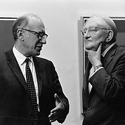 """Good friends cartoonist Saul Steinberg and Josef Albers at exhibition of Albers paintings. Published in Jon Naar's """"Getting the Picture,"""" 2005.  Talem with a 35 mm Nikon FM in 1972."""