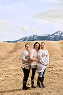 Sisters, walking, foothills of Absaroka Mountains, southwest of Livingston, Montana, Reinke Family