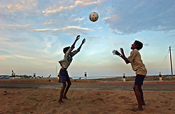Children play on the beach across the bay where all nearly of their homes and boats were destroyed  after the deadly tsunami hit last December 26 in the village of Muzuku Thurai near Cuddalore in Tamil Nadu, India August 26, 2005. Aid agencies  are providing entertainment for children in an effort to help them recover from the severe psycho-social health problems endemic to a catastrophe of this scale. Recovery is slow eight months after the deadly tsunami killed thousands, destroyed homes and livelihoods. The situation is still grim for many who suffer from poor living conditions, depression and many have taken up  alcohol as a means to escape.  (Ami Vitale)