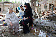 Nowshera: UNHCR Goodwill Ambassador, Angelina Jolie meets 64 year old Zenul Hawa at her flood damaged home in the village of Mohib Bandi, on the outskirts of Nowshera, Khyber  Pakhtunkhwa. Her home was one of the first to be flooded, located just 200m from the banks of the Kabul River.<br /> <br /> Pakistan. /UNHCR/Jason Tanner/September 2010