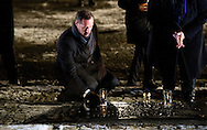 27-1- 2015 AUSCHWITZ -  King Willem Alexander and Queen Maxima from the Netherlands  are laying a candle at the monument in Camp Birkenau  during the the 70 years commemoration in Camp Auschwitz II­ Birkenau  in poland . COPYRIGHT ROBIN UTRECHT