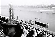 A woman enjoys a Dragon Boat race in the Yangtze river in Yichang