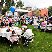 Since 2003, Tufts has partnered with the cities of Somerville and Medford in Community Day. Local residents are invited to visit the campus and enjoy music and dance performances, educational demonstrations from various Tufts departments, interactive displays from student groups, kids activities, and a free lunch. Dozens of community based agencies and city departments also present information about their work. (Everett Wallace for Tufts University)