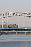 blue tram seen crossing pilsudski bridge from krakow's kazimierz district to podgorze in sunshine in september 2005